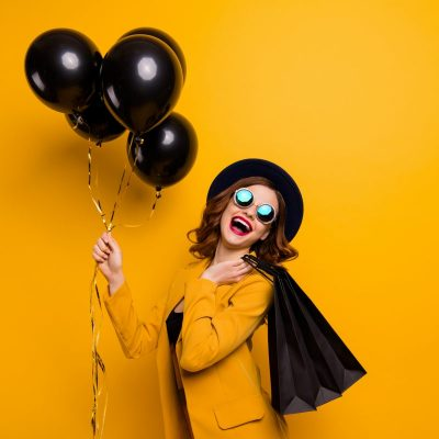 Close up side profile photo beautiful she her lady laugh laughter carry packs perfect look buy buyer present gift birthday discount wear specs formal-wear costume isolated yellow bright background.